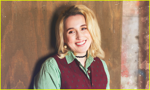 Harley Quinn Smith smiles to someone off to the side of the camera