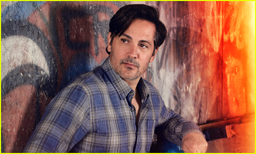 Michael Landes looks off to the side in a flannel shirt