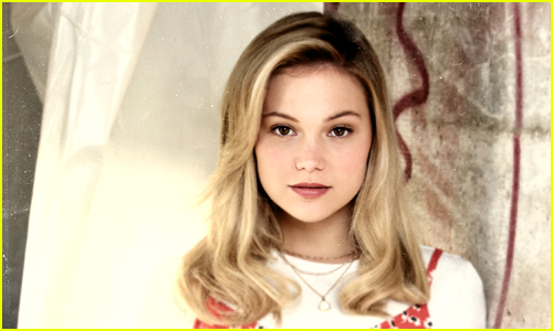 Olivia Holt looks at the camera with her hair down