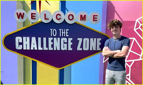 Owen Holt poses next to a Las Vegas style sign