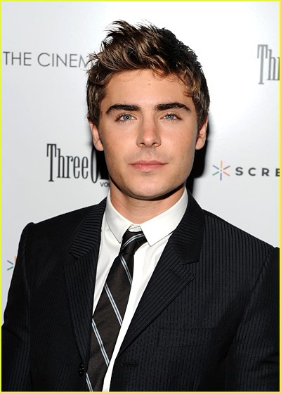 Zac Efron wears a black suit to a red carpet event