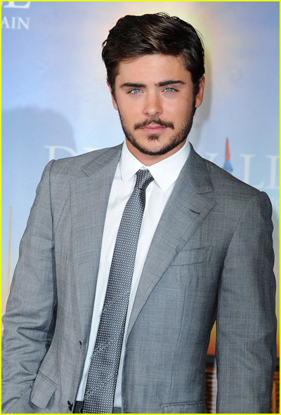 Zac Efron wears a grey suit to a movie premiere