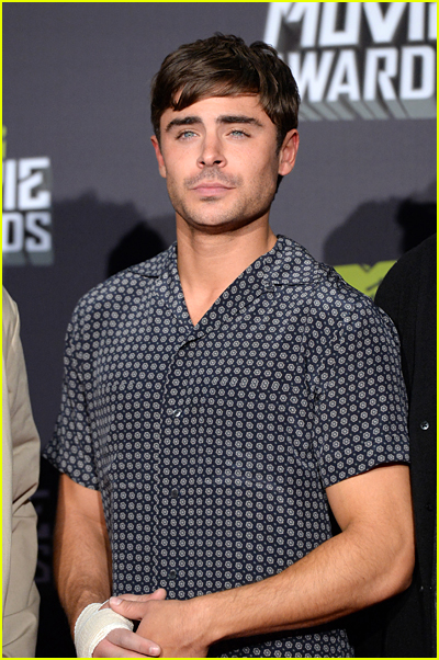 Zac Efron has a bandage on his hand