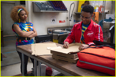 Dara Renee and Roman Banks in the pizza shop on HSMTMTS