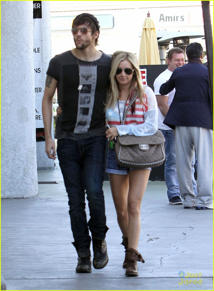 How long have ashley tisdale and martin johnson been dating
