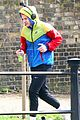 harry styles sports colorful jacket while jogging in london 01