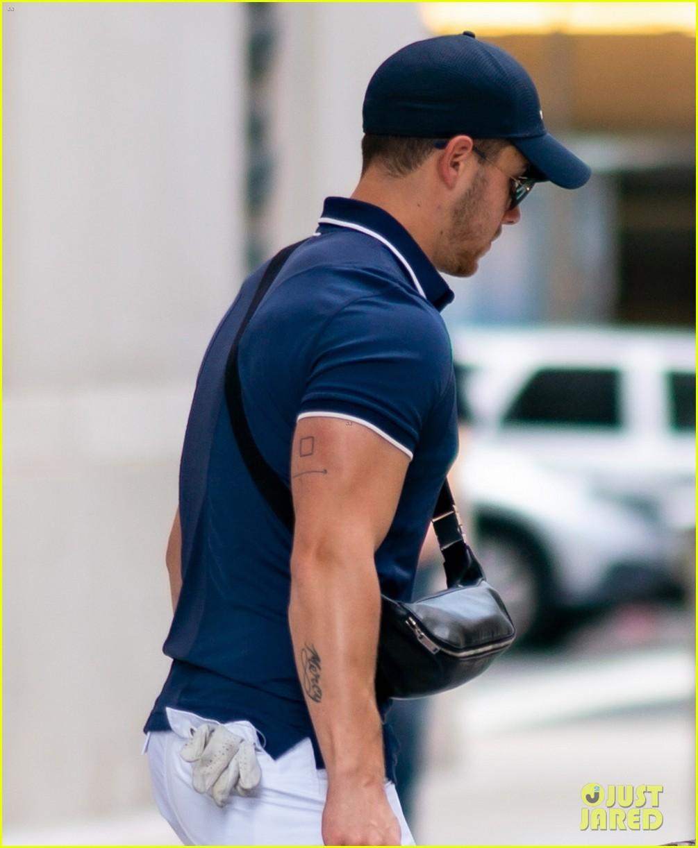 nick jonas looks muscular while heading to play golf 02