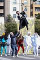 harry styles zip lines over la street for late late show segment 03