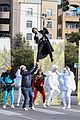 harry styles zip lines over la street for late late show segment 24