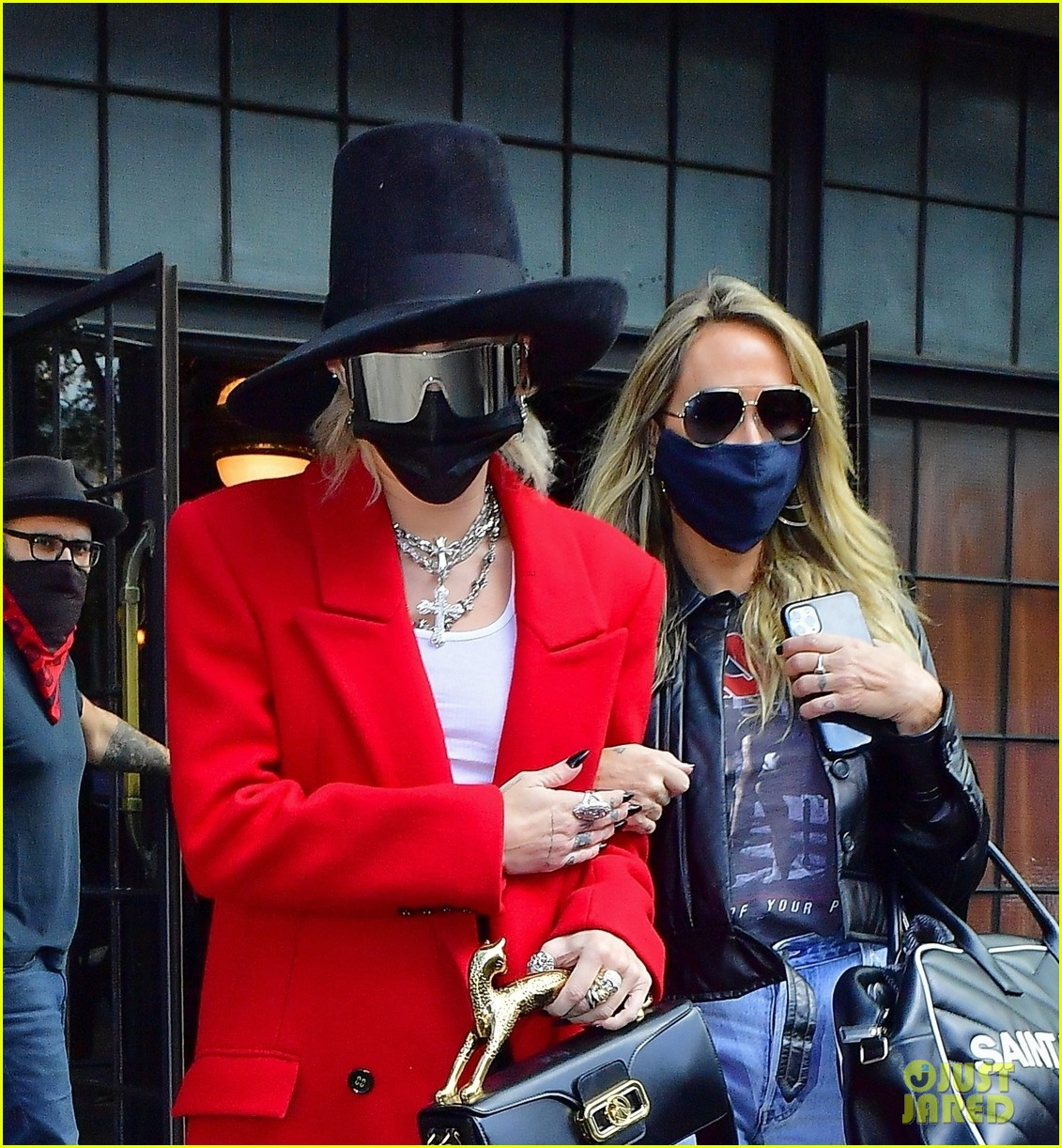 miley cyrus tophat red coat leaving hotel mom nyc 07
