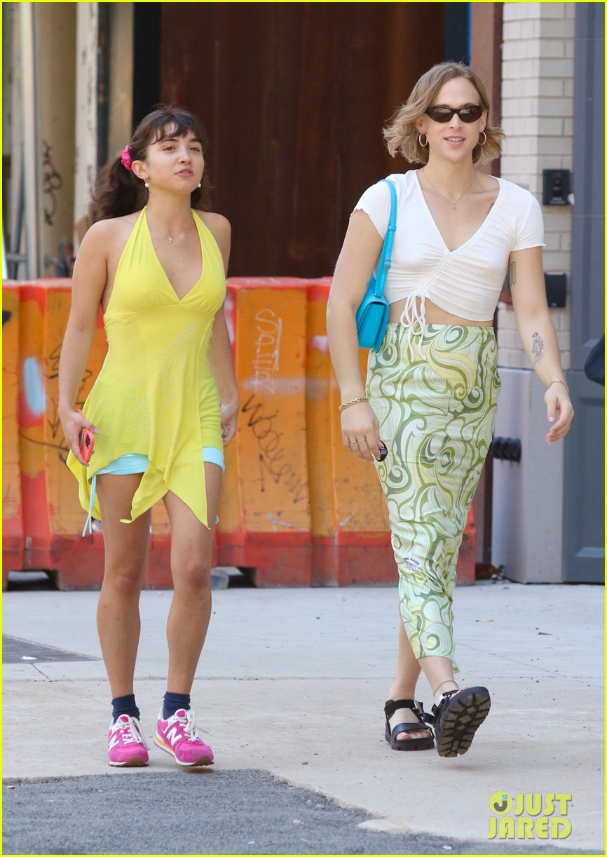 tommy dorfman carries bright blue bag out with rowan blanchard 05