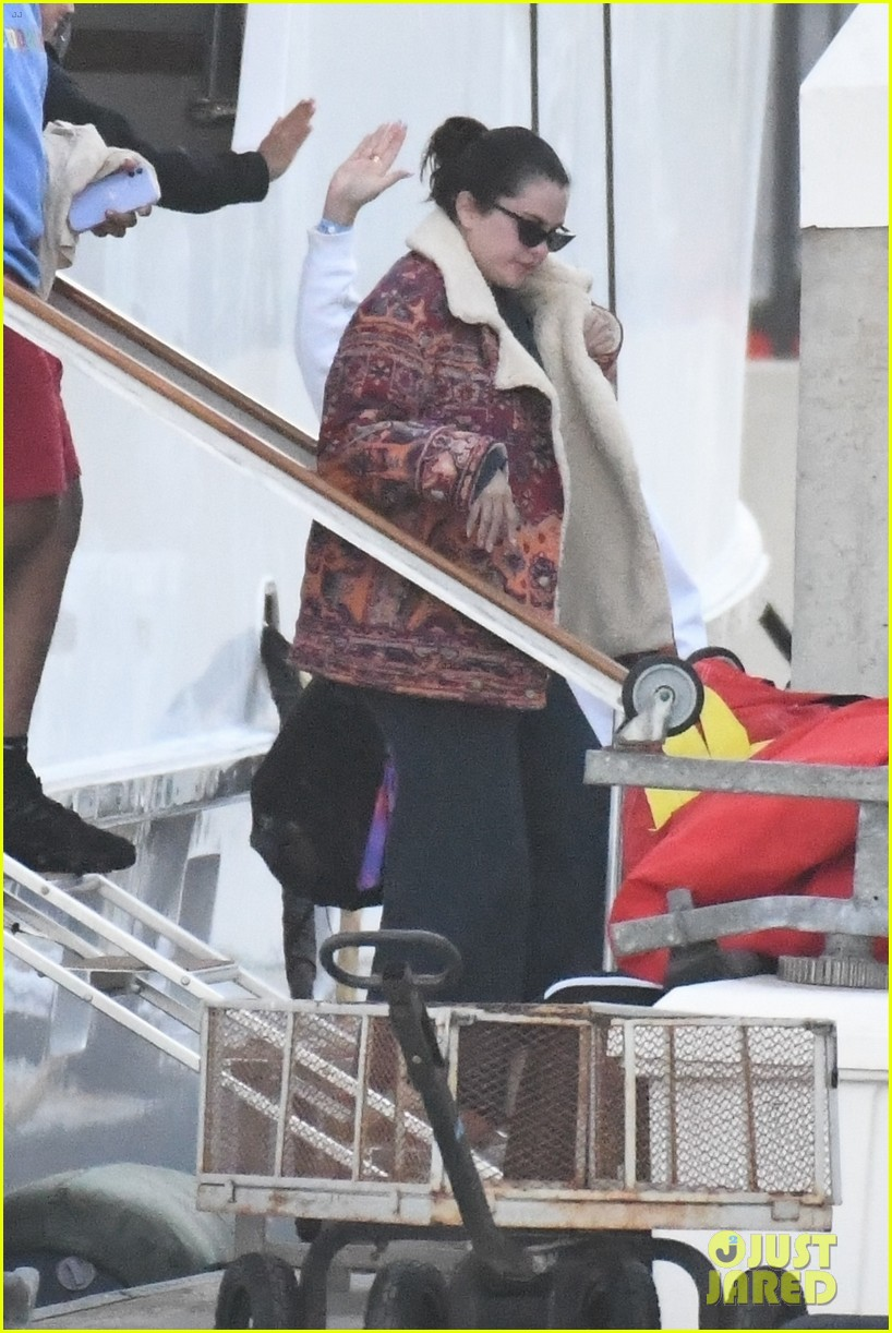 selena gomez boards a yacht for quick trip with friends 01