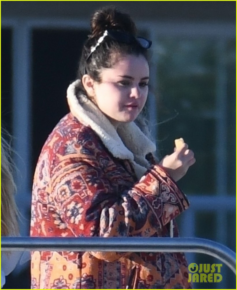 selena gomez boards a yacht for quick trip with friends 02