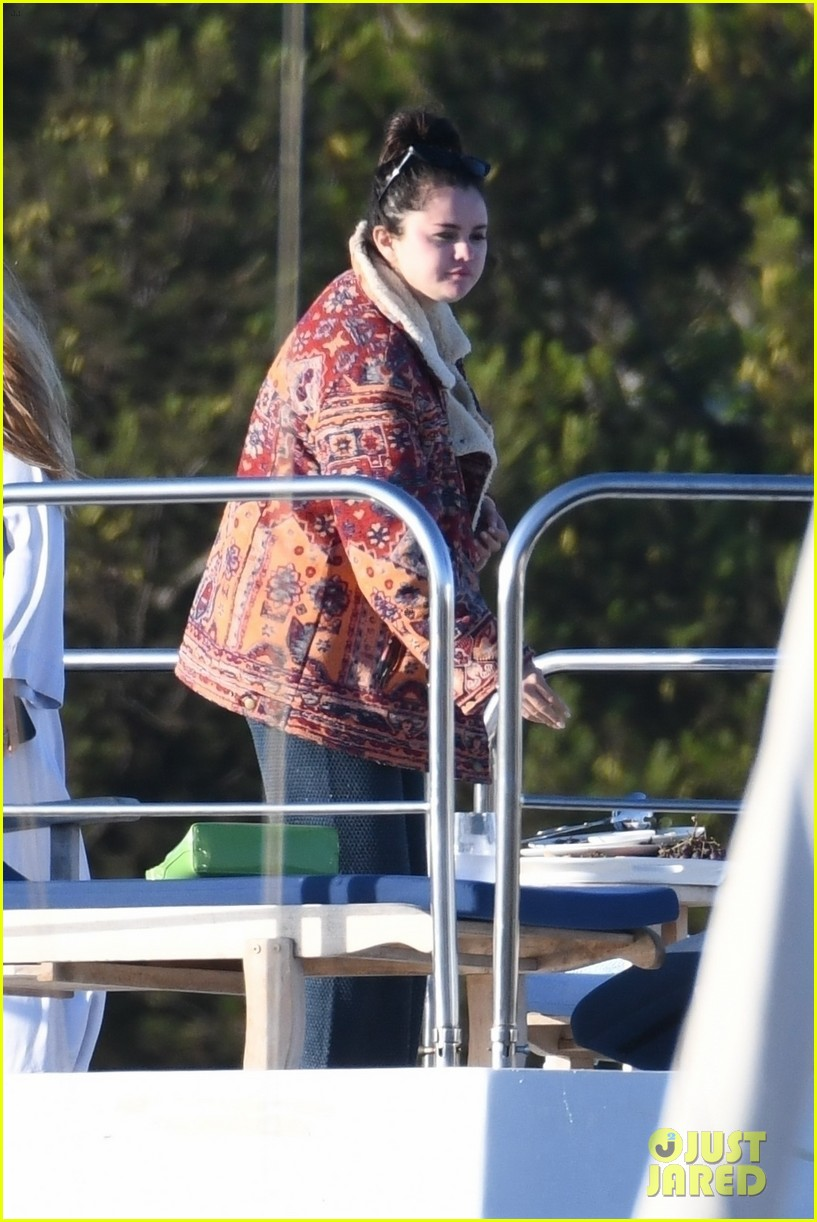 selena gomez boards a yacht for quick trip with friends 03