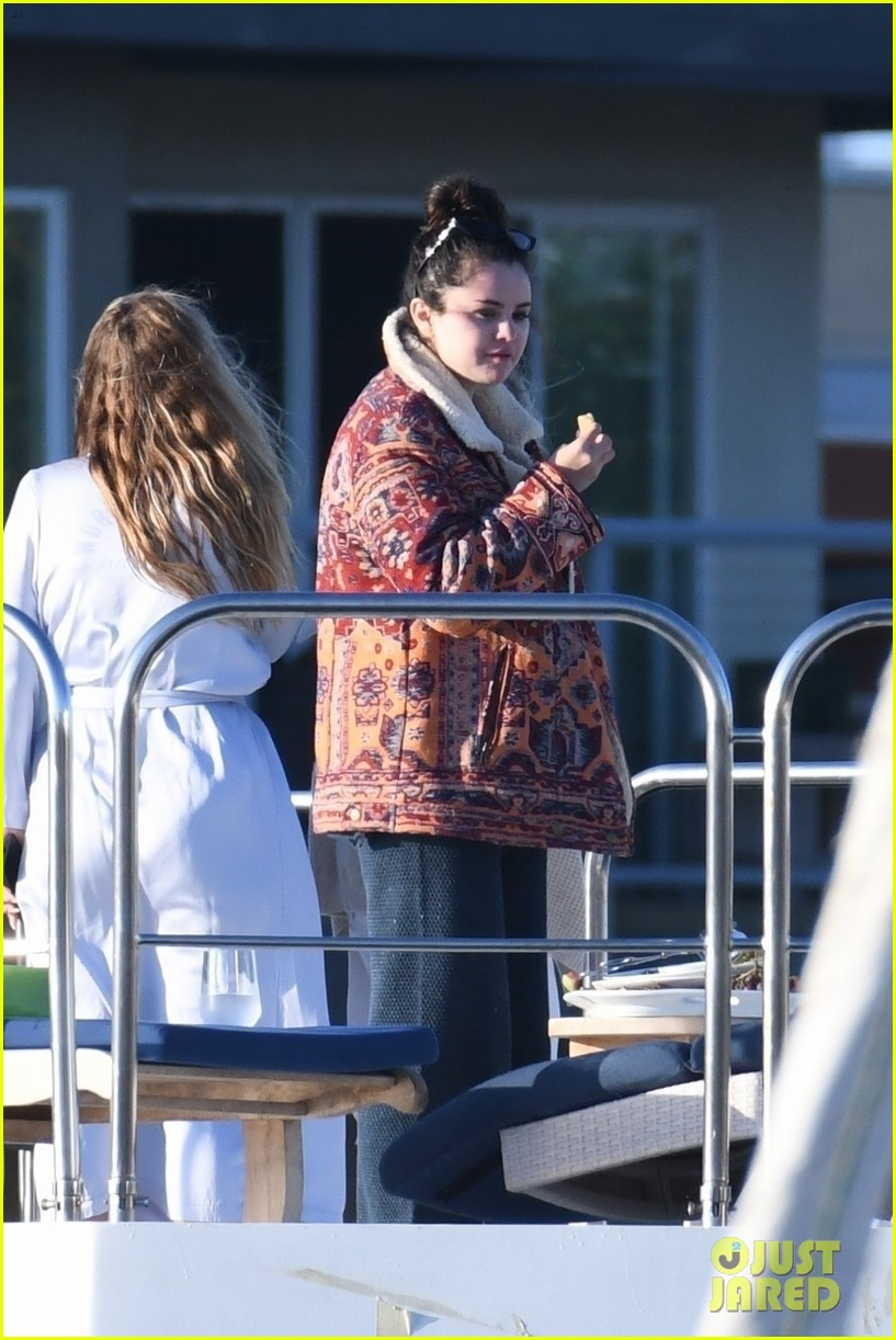 selena gomez boards a yacht for quick trip with friends 05
