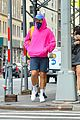 harry styles sports bright pink hooding while hanging out with friends 05