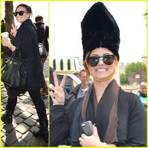 Demi Lovato Rocks A Bearskin Hat While Touring London