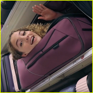 Sofie Dossi Squeezes Into a Suitcase in Public!