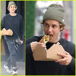 Justin Bieber Eats Avocado Toast While Walking Down the Sidewalk