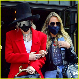 Miley Cyrus Wears a Top Hat & Chic Red Coat For Business Meeting in NYC