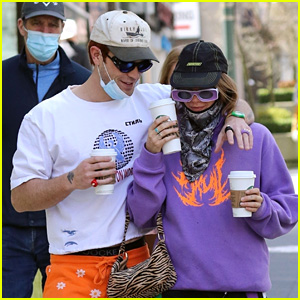 KJ Apa Picks Up Coffee To Go With Girlfriend Clara Berry During Walk in Vancouver